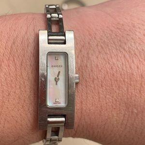 Gucci ladies silver tone watch